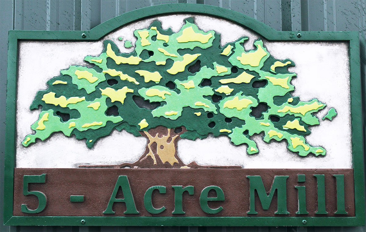 Image of a custom made wood tree sign showing our craftsmenship.